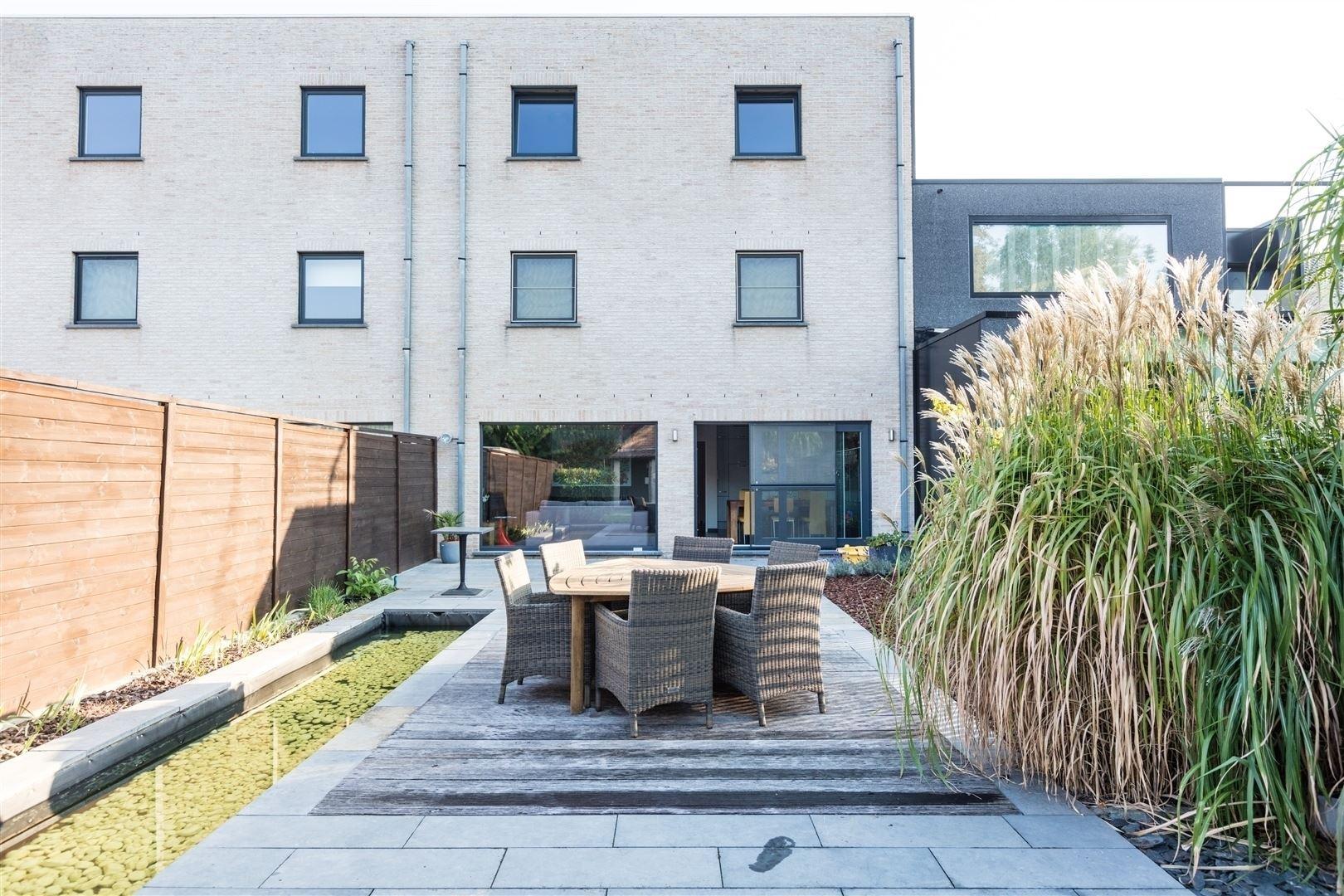 Gelijkvloers appartement met zuid gerichte tuin